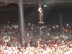 Drake flies over the Chicago crowd during the Drake vs. Lil Wayne tour on Sunday, August 10, 2014. Photo by Devin Torkelsen.